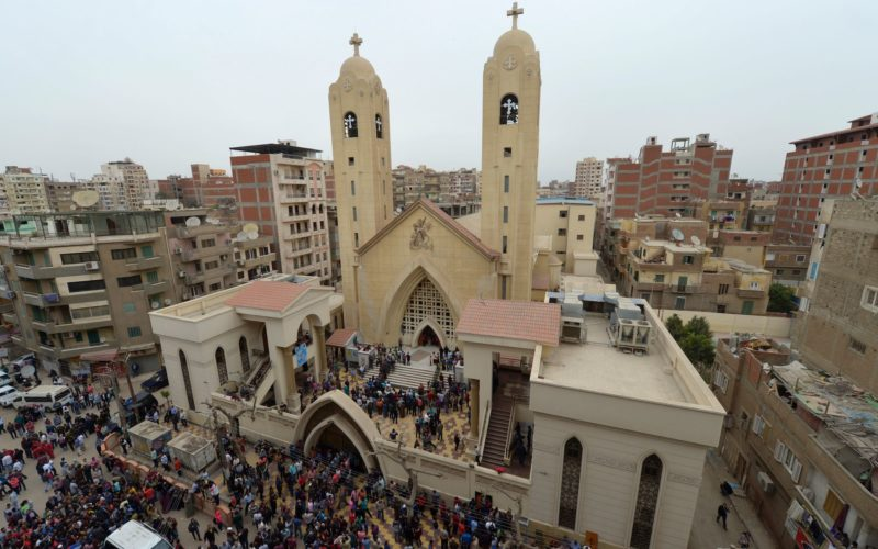 A general view shows people gathering outside the Mar Girgis Coptic Church in the Nile Delta City of Tanta, 120 kilometres (75 miles) north of Cairo, after a bomb blast struck worshippers gathering to celebrate Palm Sunday on April 9, 2017. / AFP PHOTO / KHALED DESOUKI (Photo credit should read KHALED DESOUKI/AFP/Getty Images)
